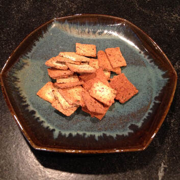Almond crackers in a plate made by Willi Singleton.