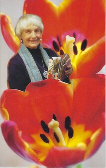 A SoulCollage card with an image of Seena Frost with some red poppies.